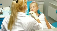 Orthodontist with Little Girl Patient - stock footage