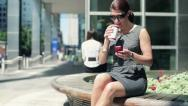 Businesswoman with coffee and smartphone in the city, steadicam shot HD Stock Footage