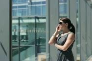 Businesswoman talking on cellphone, steadicam shot NTSC Stock Footage