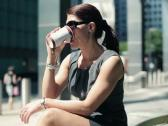 Businesswoman drinking coffee in the city, steadicam shot NTSC Stock Footage