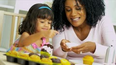 African American Mother Child Decorating Cupcakes Stock Footage