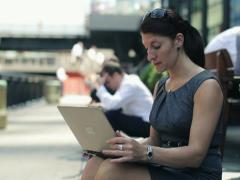 Businesswoman working on laptop in the city, steadicam shot NTSC - stock footage