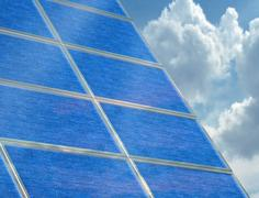 Solar panel array on a cloudy day Stock Illustration