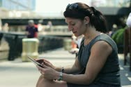 Young businesswoman with tablet computer in the city, steadicam shot NTSC Stock Footage
