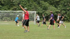 Beginning an Ultimate Frisbee play Stock Footage