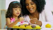 Cute Child Mom Decorating Cupcakes Stock Footage