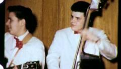 Teenager Plays Guitar Teen Rock and Roll Band 1950s Vintage Film Home Movie 3124 Stock Footage