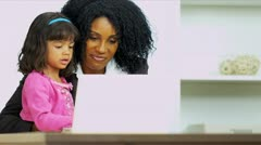 Cute Child Watching Working Mother Laptop - stock footage