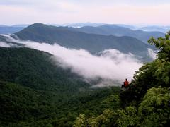 Lone Hiker atop Appalachian Mountain above the clouds.JPG - stock photo
