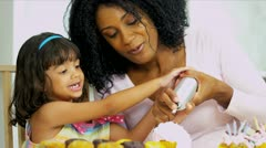 Pretty Mother Young Child Icing Cupcakes - stock footage