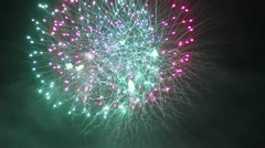 A beautiful fireworks in the night sky Stock Footage