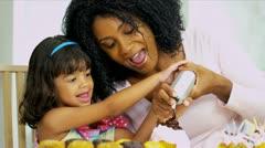 Little Ethnic Girl Young Mom Baking - stock footage