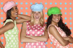 Teenage girls posing with hats and polka dots Stock Photos