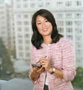 Businesswoman using a electronic organizer Stock Photos