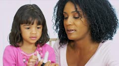Cute Little Girl Copying Mom with Lipstick - stock footage