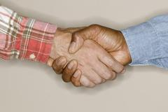 Close up of handshake Stock Photos