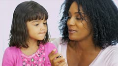 Young Ethnic Mom Daughter Using Cosmetics Stock Footage