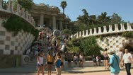 Pan from crowded entrance Park Güell Stock Footage