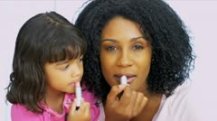 Cute Little Girl Playing With Lipstick - stock footage