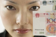 Close up portrait of woman holding foreign currency - stock photo