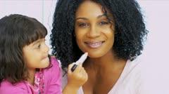 Pretty Ethnic Mom Daughter Using Cosmetics Stock Footage