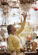 Woman shopping in antique store Stock Photos
