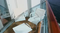 Two chairs and table at balcony on vessel which floats in sea Stock Footage
