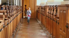 Boy walk  in church and mother wait behind Stock Footage