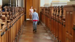 Boy walk away  in church and mother wait behind Stock Footage