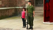 Stock Video Footage of Little boy repeats movement of soldier with rifle on guard