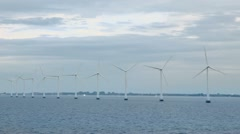 Several windmills for electric energy generation in sea Stock Footage