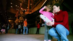 Mom and daughter read booklet in Vasa Museum - stock footage