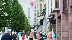 Many citizens walk by street in Stockholm Stock Footage