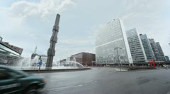 Cars ride by road near Sergels Torg Fountain Stock Footage
