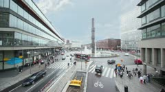 Cars and people traffic at Sergels Torg with fountain Stock Footage