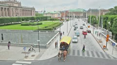 Traffic on street above museum of medieval Stockholm Stock Footage