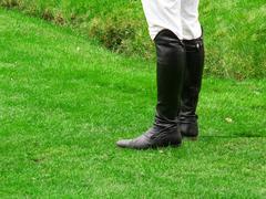 Black riding boots Stock Photos