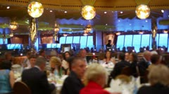 Many people sit at tables in restaurant on ship during cruise Stock Footage