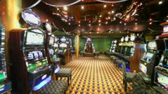 Motion through empty casino with lot of play machines around Stock Footage