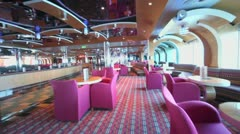 Motion through empty night club at day on ship during cruise Stock Footage