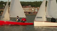 Two dinghies or sailboats sailing on lake Stock Footage