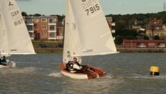 Two people sail dinghy or sail boat on lake Stock Footage