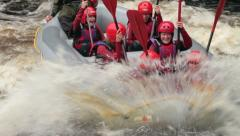 Raft hitting wave on white water, river tryweryn, bala, wales Stock Footage