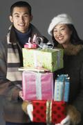 Young couple with holiday gifts Stock Photos