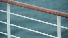 Fence with wooden handrail on deck of ship which floats in sea Stock Footage