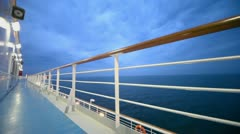 Empty deck of ship which float on sea at evening during cruise Stock Footage