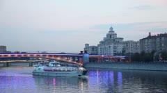 Ship floats near Smolensky metro bridge and traffic on quay Stock Footage