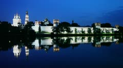 Complex of Novodevichy Convent with illumination beyond wall Stock Footage