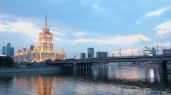 Ship floats near Novoarbatsky bridge with high-rise building Stock Footage