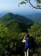 Lone Hiker Drinks Water atop Appalachian Mountain.JPG Stock Photos